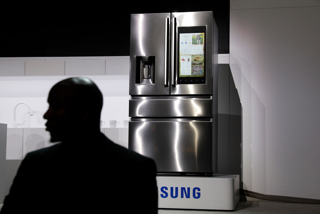 . A refrigerator with Family Hub 2.0 is on display during a Samsung news conference before CES International, Wednesday, Jan. 4, 2017, in Las Vegas. Family Hub 2.0 features an interface on the refrigerator with apps that can be controlled by voice recognition. (AP Photo/John Locher)