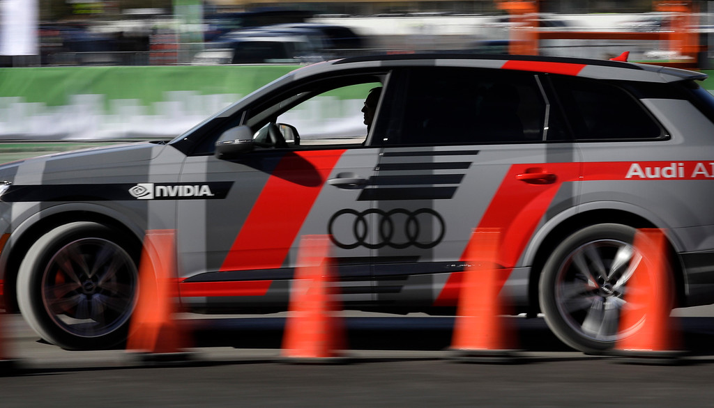. An autonomous car controlled by a Nvidia DRIVE PX 2 AI car computing platform drives passengers along a course during CES International, Friday, Jan. 6, 2017, in Las Vegas. (AP Photo/John Locher)