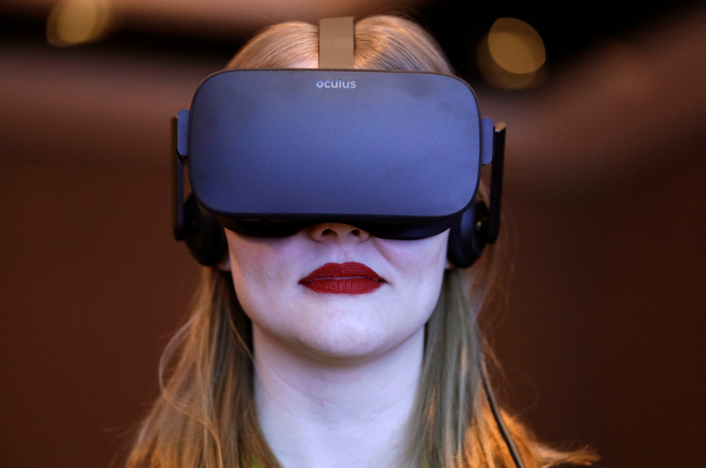 . Meghan Puhr participates in a virtual realty presentation during an Intel news conference before CES International, Wednesday, Jan. 4, 2017, in Las Vegas. (AP Photo/John Locher)