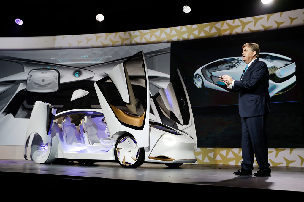 . Bob Carter, senior vice president of automotive operations for Toyota, introduces the Toyota Concept-i during a news conference at CES International Wednesday, Jan. 4, 2017, in Las Vegas. (AP Photo/Jae C. Hong)