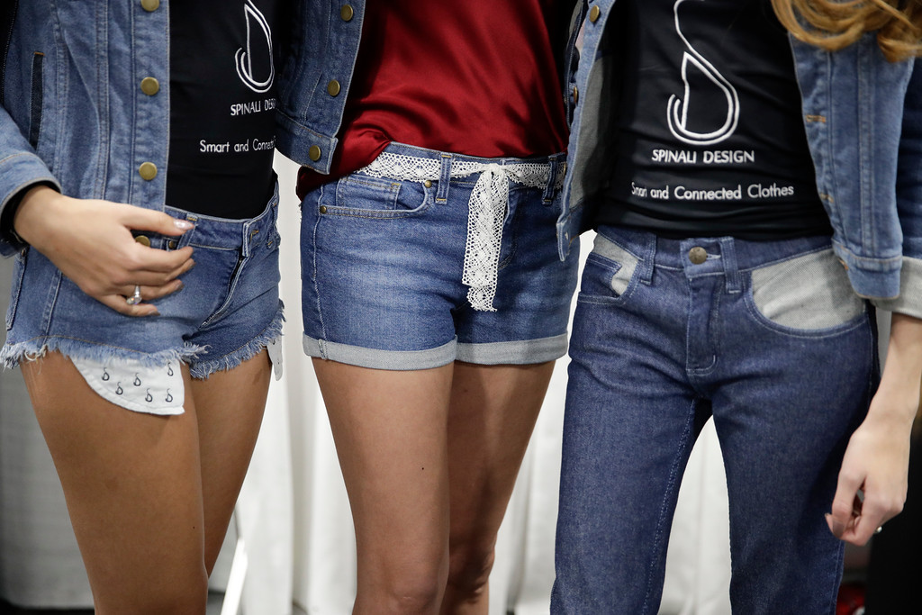 . Models wear jeans from Spinali Designs at CES International Friday, Jan. 6, 2017, in Las Vegas. The $100 jeans will vibrate on your right or left hip to let you know which direction you should head. (AP Photo/Jae C. Hong)