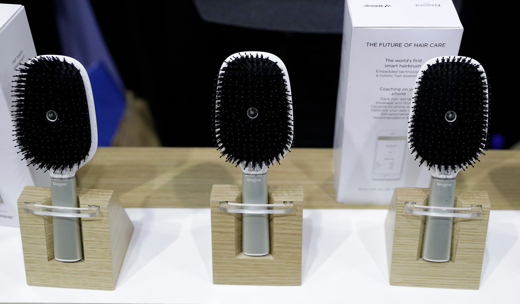 . Hair Coach smart hairbrushes are displayed at the Withings booth during CES Unveiled before CES International, Tuesday, Jan. 3, 2017, in Las Vegas. The brush uses sensors to track hair damage and will, via a smart-phone app, offer recommendations and advice on hair care. (AP Photo/John Locher)