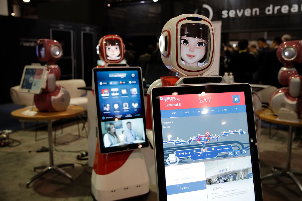 . Furo smart service robots are demonstrated at CES International Friday, Jan. 6, 2017, in Las Vegas. (AP Photo/Jae C. Hong)