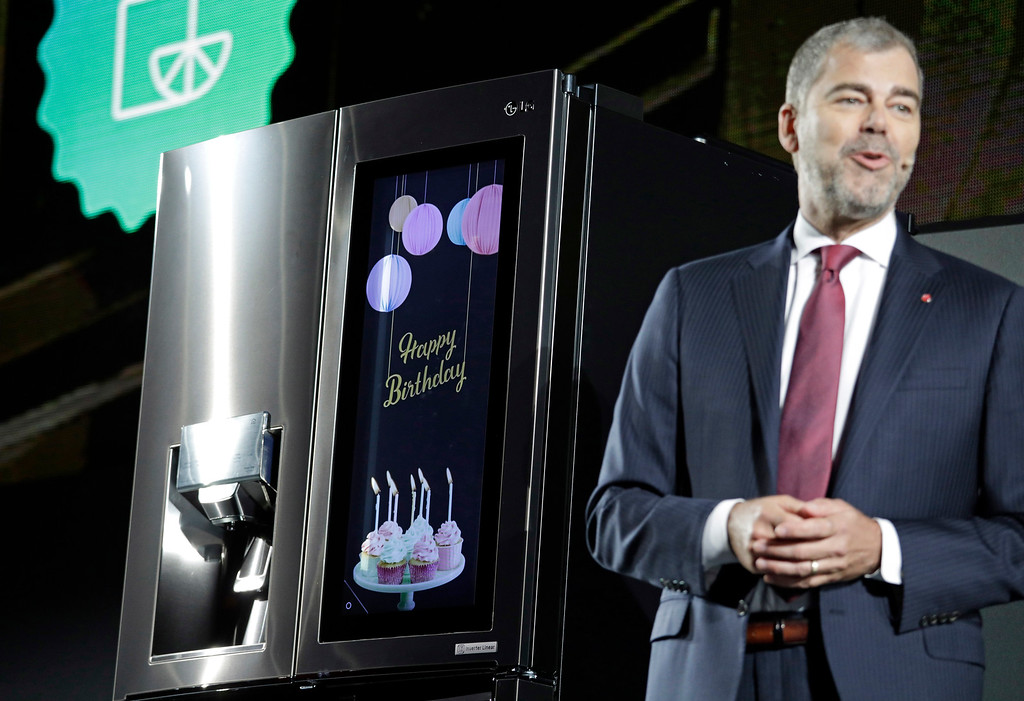 . David VanderWaal, vice president of marketing for LG Electronics USA, unveils the LG InstaView Door-in-Door refrigerator during an LG news conference before CES International, Wednesday, Jan. 4, 2017, in Las Vegas. (AP Photo/John Locher)