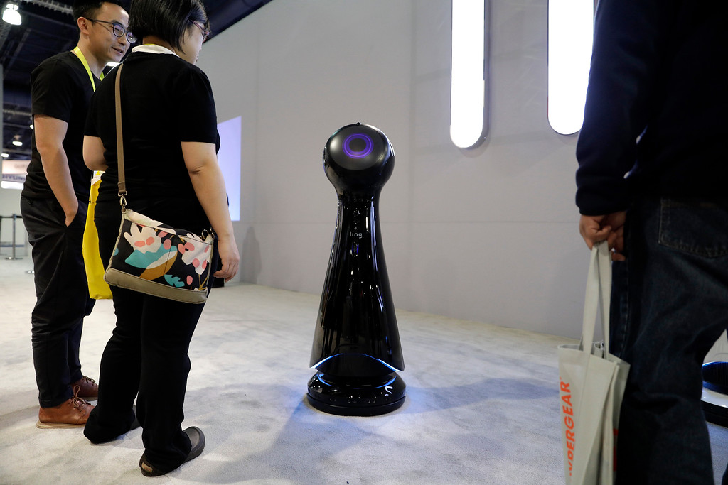 . A Wavebot moveable service robot moves around the Ling booth during CES International, Thursday, Jan. 5, 2017, in Las Vegas. (AP Photo/John Locher)