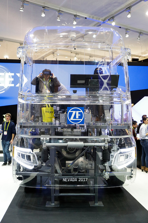 . Attendees watch a presentation using VR headsets at the ZF booth at CES International Thursday, Jan. 5, 2017, in Las Vegas. (AP Photo/Jae C. Hong)