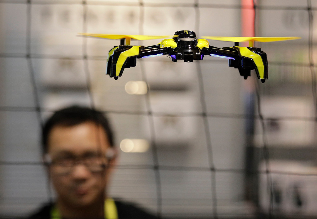 . The Phoenix drone flies at the TDR booth during CES International, Thursday, Jan. 5, 2017, in Las Vegas. (AP Photo/John Locher)