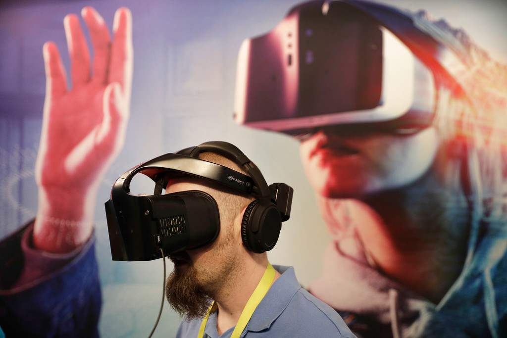 . Brian St. George wears a Project Alloy VR headset at the Intel booth during CES International, Friday, Jan. 6, 2017, in Las Vegas. (AP Photo/John Locher)