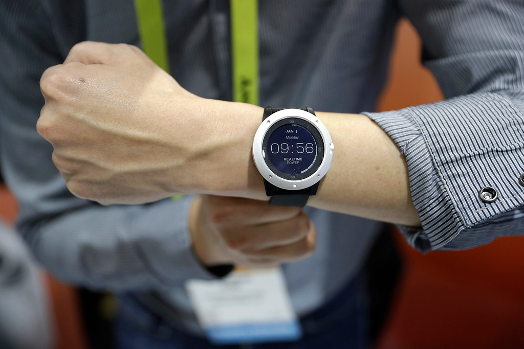 . An employee demonstrates the Matrix Powerwatch during CES Unveiled before CES International, Tuesday, Jan. 3, 2017, in Las Vegas. The smart watch is powered by body heat from the wearer. (AP Photo/John Locher)