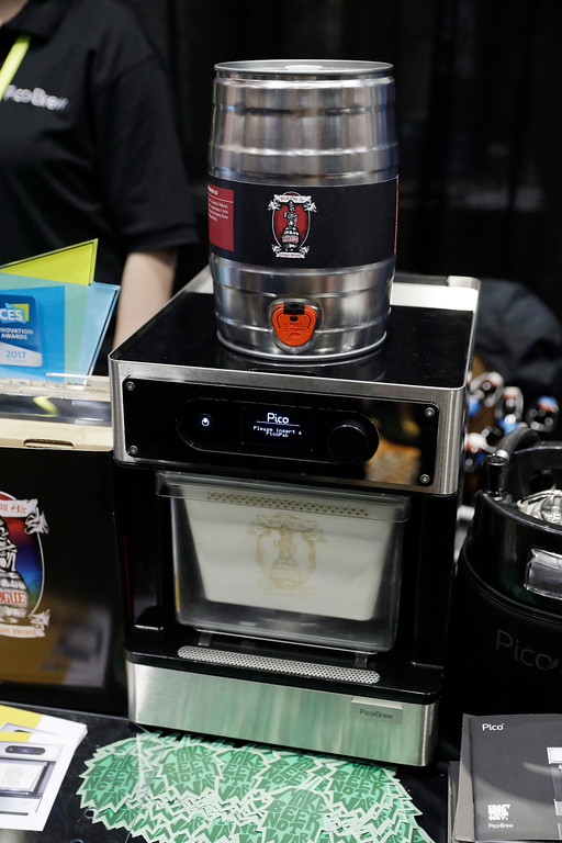 . The PicoBrew automatic home beer brewer is displayed during CES Unveiled before CES International, Tuesday, Jan. 3, 2017, in Las Vegas. (AP Photo/John Locher)