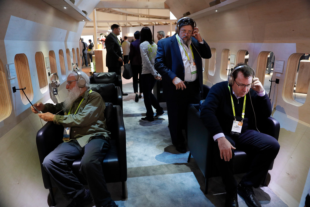 . People listen to music with Sony\'s noise-canceling headphones at the Sony booth at CES International Thursday, Jan. 5, 2017, in Las Vegas. (AP Photo/Jae C. Hong)