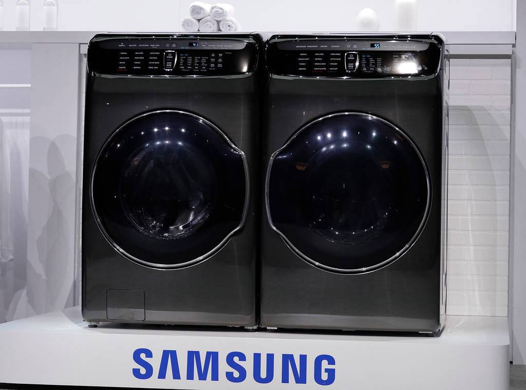. The FlexWash and FlexDry are unveiled during a Samsung news conference before CES International, Wednesday, Jan. 4, 2017, in Las Vegas. (AP Photo/John Locher)