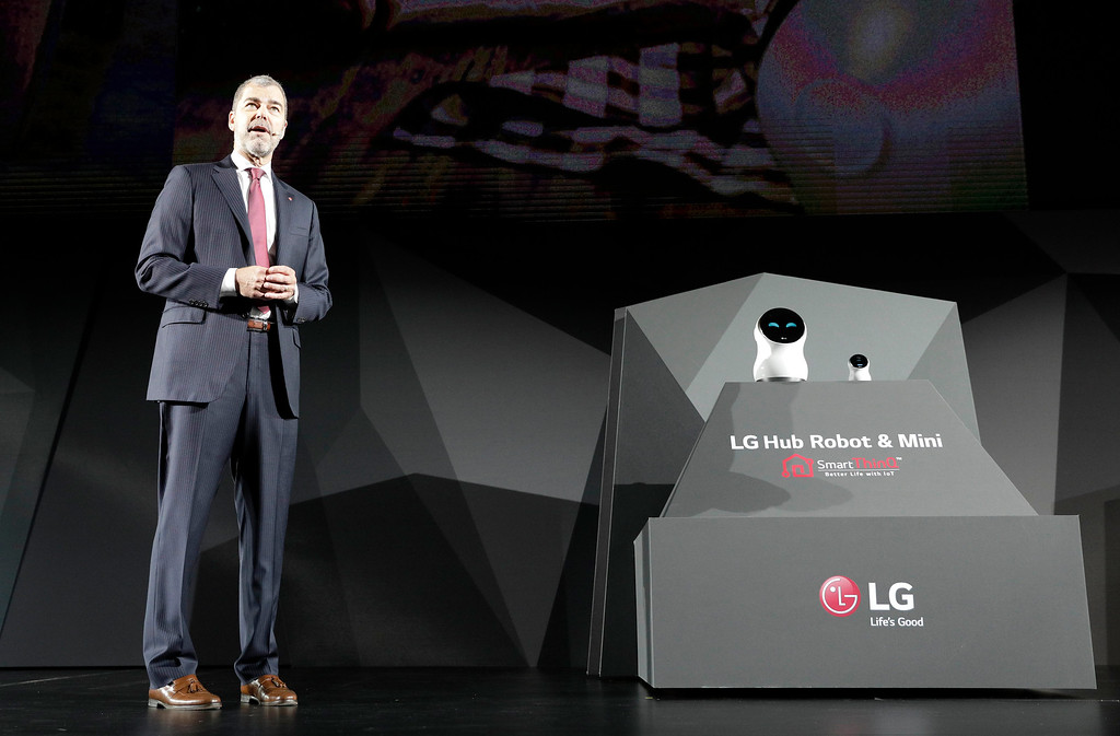 . David VanderWaal, vice president of marketing for LG Electronics USA, unveils the LG Hub Robot & Mini are unveiled during an LG news conference before CES International, Wednesday, Jan. 4, 2017, in Las Vegas. (AP Photo/John Locher)