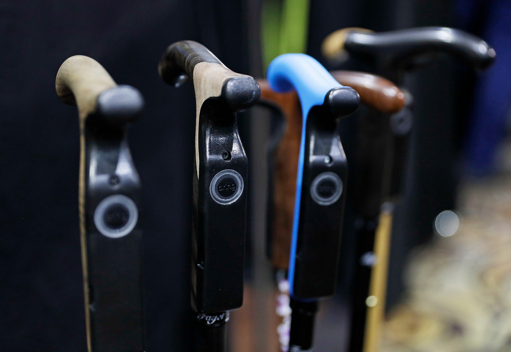 . The Smartcane is on display during CES Unveiled before CES International, Tuesday, Jan. 3, 2017, in Las Vegas. The cane can understand a user\'s habits and detect unusual situations and alert a caregiver. (AP Photo/John Locher)