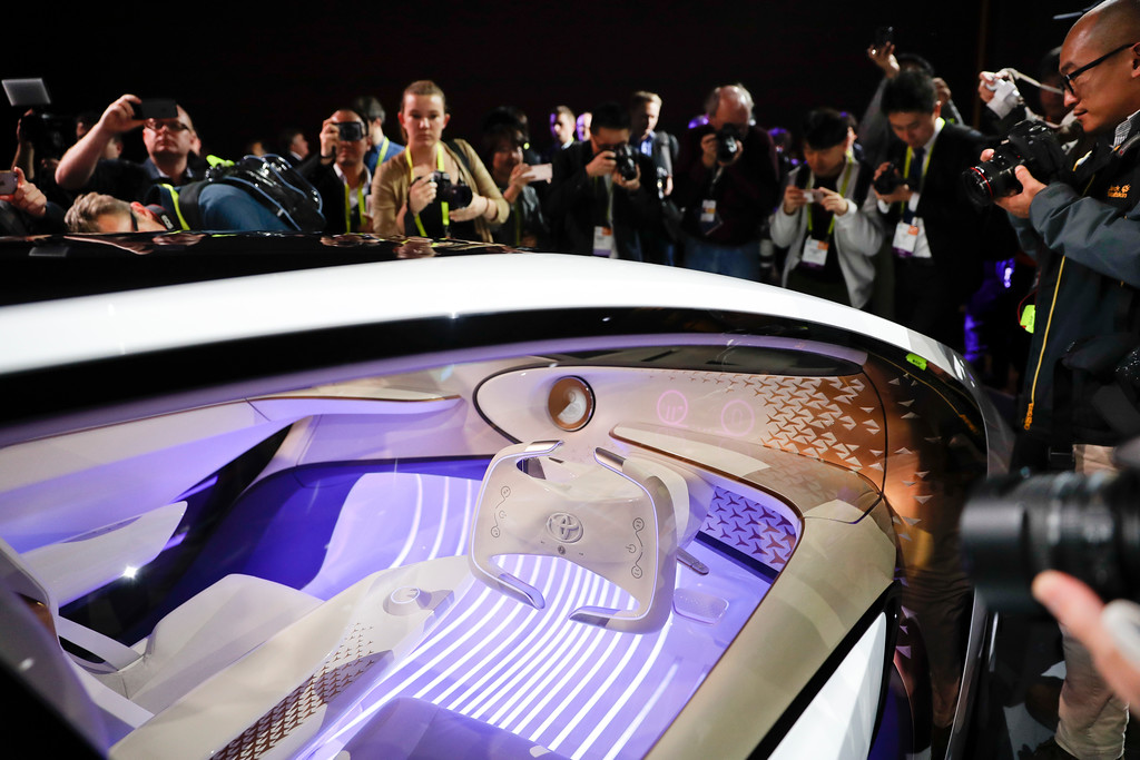 . People take pictures of the Toyota Concept-i during a news conference at CES International Wednesday, Jan. 4, 2017, in Las Vegas. (AP Photo/Jae C. Hong)