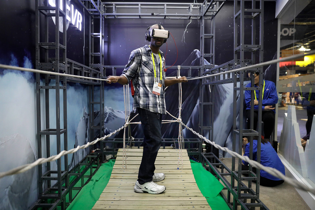 . Fiifi Blankson uses a virtual reality device at the ZTE booth during CES International, Thursday, Jan. 5, 2017, in Las Vegas. (AP Photo/John Locher)