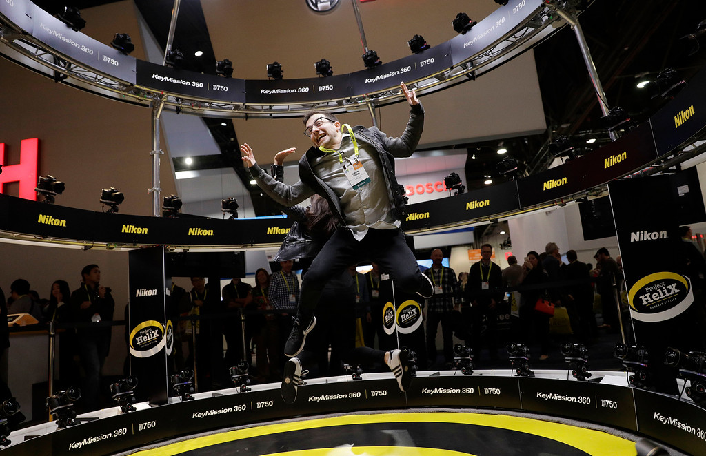 . Simon Rosen jumps while having his picture taken in the Project Helix at the Nikon booth during CES International, Thursday, Jan. 5, 2017, in Las Vegas. (AP Photo/John Locher)