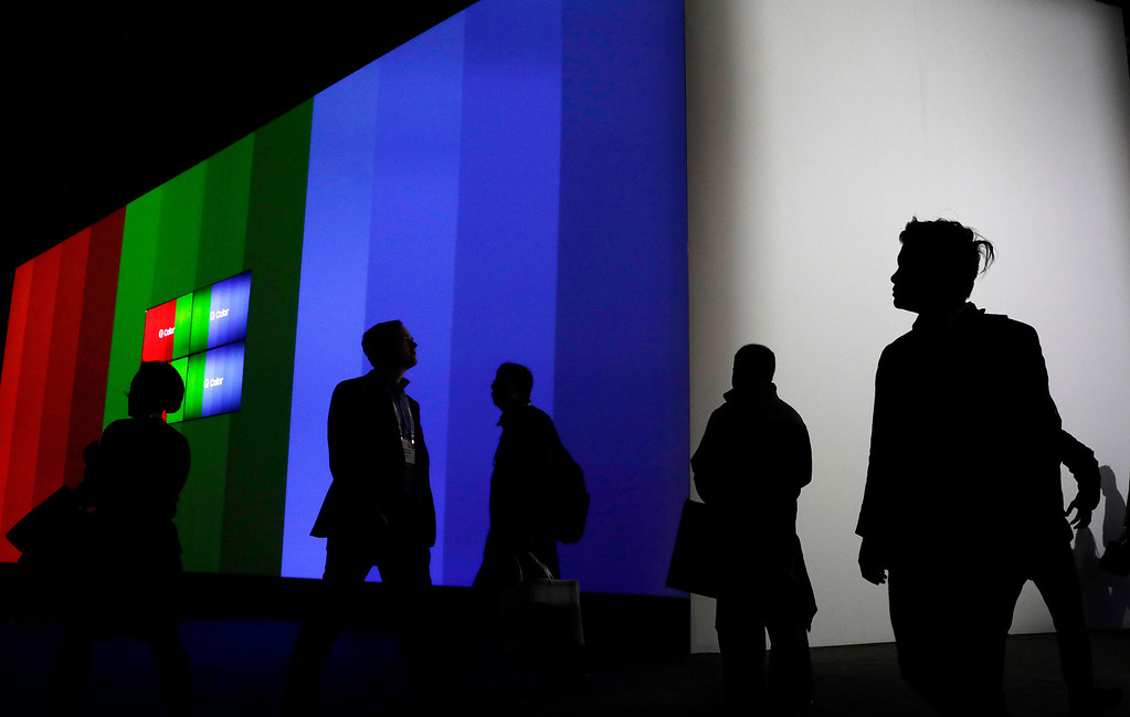 . Attendees walk through the Samsung booth during CES International, Friday, Jan. 6, 2017, in Las Vegas. (AP Photo/John Locher)