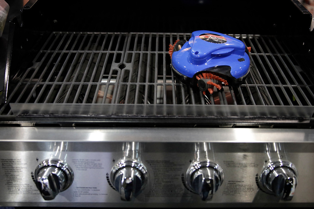 . Grillbot, a grill cleaning robot, is demonstrated at CES International Friday, Jan. 6, 2017, in Las Vegas. (AP Photo/Jae C. Hong)