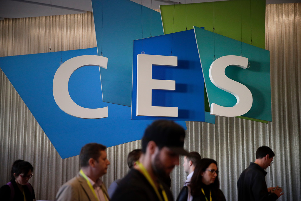 . Show attendees walks past the CES sign at CES International Friday, Jan. 6, 2017, in Las Vegas. (AP Photo/Jae C. Hong)