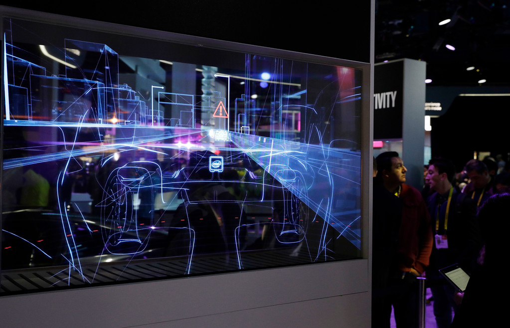 . A translucent screen shows smart car technology at the Intel booth during CES International, Friday, Jan. 6, 2017, in Las Vegas. (AP Photo/John Locher)