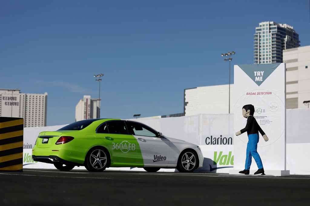 . People ride in a car with a Valeo 360 automatic electronic braking system during CES International, Friday, Jan. 6, 2017, in Las Vegas. (AP Photo/John Locher)