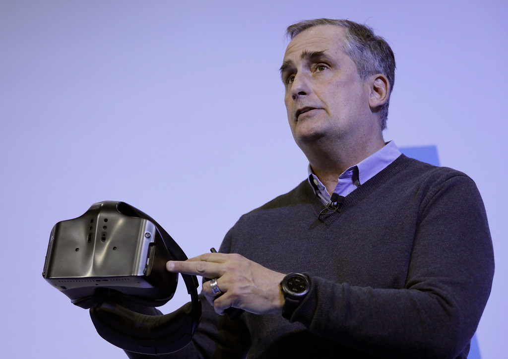 . Intel CEO Brian Krzanich holds a Project Alloy all-in-one merged reality headset during an Intel news conference before CES International, Wednesday, Jan. 4, 2017, in Las Vegas. (AP Photo/John Locher)