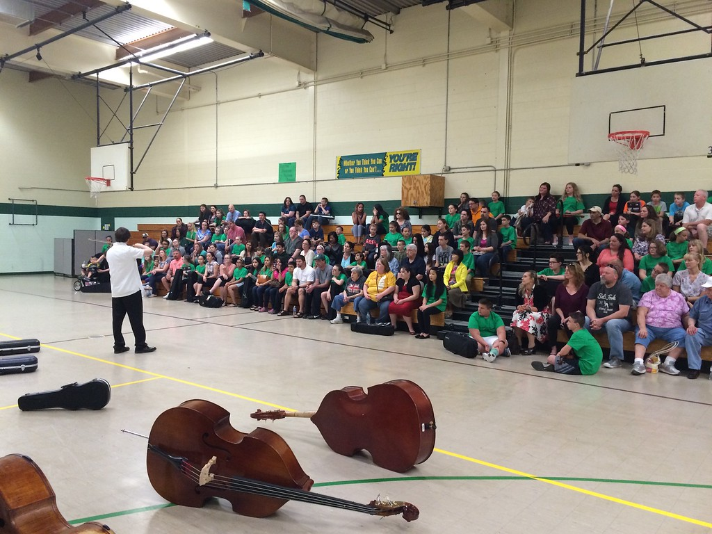 . Submitted photo - Northern Ohio Youth Orchestra <br> Northern Ohio Youth Orchestra coach and Oberlin Conservatory Student Greg Gennaro performs for students and parents. on April 25, 2016. The Northern Ohio Youth Orchestra and Amherst schools collaborated for an evening of studying strings at Nord Middle School. Students in grades five and six received coaching from NOYO staff.