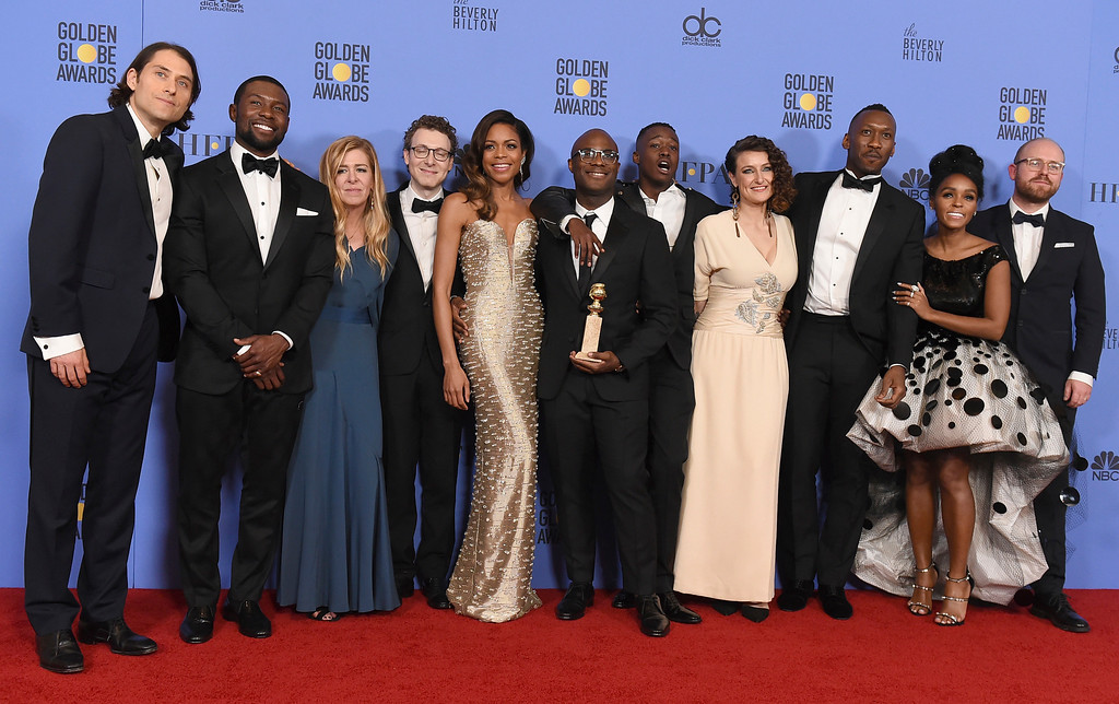 """. The cast and crew of \""""Moonlight\"""" pose in press room with the award for best motion picture - drama at the 74th annual Golden Globe Awards at the Beverly Hilton Hotel on Sunday, Jan. 8, 2017, in Beverly Hills, Calif. (Photo by Jordan Strauss/Invision/AP)"""