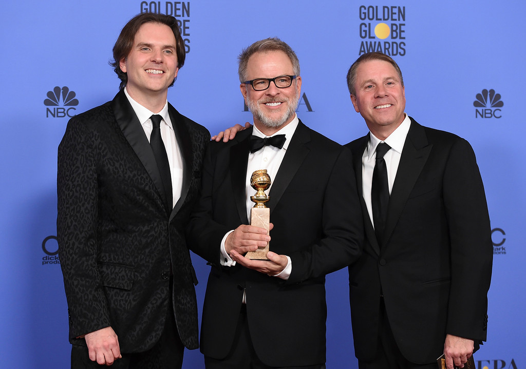 """. Byron Howard, from left, Rich Moore, and Clark Spencer pose in the press room with the award for best motion picture - animated for \""""Zootopia\"""" at the 74th annual Golden Globe Awards at the Beverly Hilton Hotel on Sunday, Jan. 8, 2017, in Beverly Hills, Calif. (Photo by Jordan Strauss/Invision/AP)"""