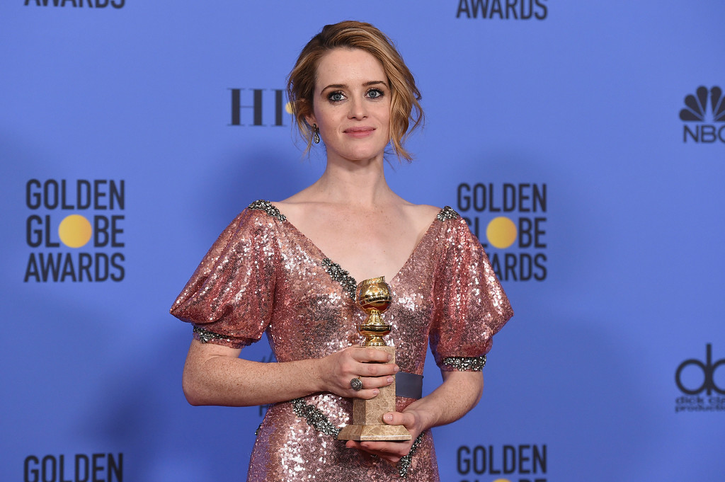 """. Claire Foy poses in the press room with the award for best performance by an actress in a television series - drama for \""""The Crown\"""" at the 74th annual Golden Globe Awards at the Beverly Hilton Hotel on Sunday, Jan. 8, 2017, in Beverly Hills, Calif. (Photo by Jordan Strauss/Invision/AP)"""