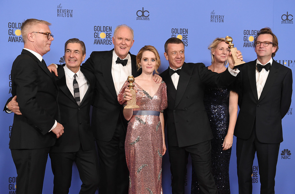 """. The cast and crew of \""""The Crown\"""" poses in the press room with the award for best television series - drama at the 74th annual Golden Globe Awards at the Beverly Hilton Hotel on Sunday, Jan. 8, 2017, in Beverly Hills, Calif. (Photo by Jordan Strauss/Invision/AP)"""