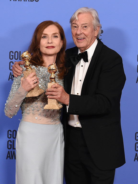 """. Isabelle Huppert, left, winner of the award for best performance by an actress in a motion picture - drama for \""""Elle\"""" and Paul Verhoeven, winner of the award for best motion picture - foreign language for \""""Elle,\"""" pose in the press room at the 74th annual Golden Globe Awards at the Beverly Hilton Hotel on Sunday, Jan. 8, 2017, in Beverly Hills, Calif. (Photo by Jordan Strauss/Invision/AP)"""