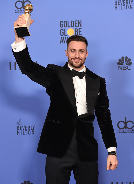 """. Aaron Taylor Johnson poses in the press room with the award for best performance by an actor in a supporting role in any motion picture for \""""Nocturnal Animals\"""" at the 74th annual Golden Globe Awards at the Beverly Hilton Hotel on Sunday, Jan. 8, 2017, in Beverly Hills, Calif. (Photo by Jordan Strauss/Invision/AP)"""