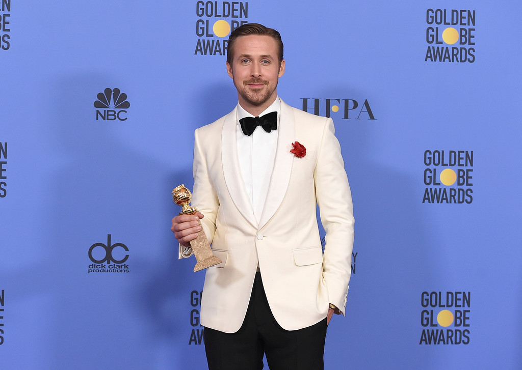 """. Ryan Gosling poses in the press room with the award for best performance by an actor in a motion picture - musical or comedy for \""""La La Land\"""" at the 74th annual Golden Globe Awards at the Beverly Hilton Hotel on Sunday, Jan. 8, 2017, in Beverly Hills, Calif. (Photo by Jordan Strauss/Invision/AP)"""