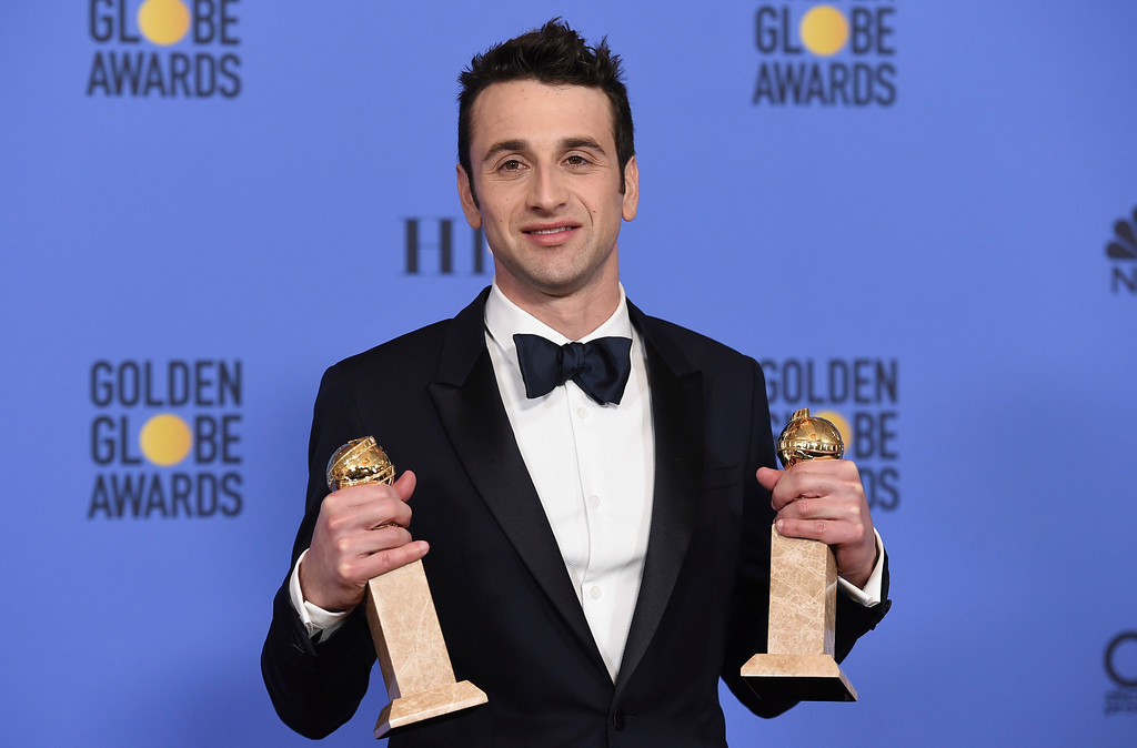 """. Justin Hurwitz poses in the press room with the award for best original song for motion picture for \""""City Of Stars\"""" and best original score - motion picture for \""""La La Land\"""" at the 74th annual Golden Globe Awards at the Beverly Hilton Hotel on Sunday, Jan. 8, 2017, in Beverly Hills, Calif. (Photo by Jordan Strauss/Invision/AP)"""