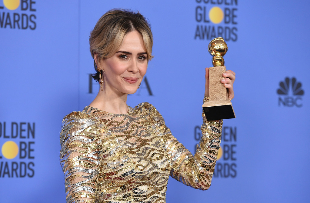 """. Sarah Paulson poses in the press room with the award for best performance by an actress in a limited series or a motion picture made for television for \""""The People v. O.J. Simpson: American Crime Story\"""" at the 74th annual Golden Globe Awards at the Beverly Hilton Hotel on Sunday, Jan. 8, 2017, in Beverly Hills, Calif. (Photo by Jordan Strauss/Invision/AP)"""