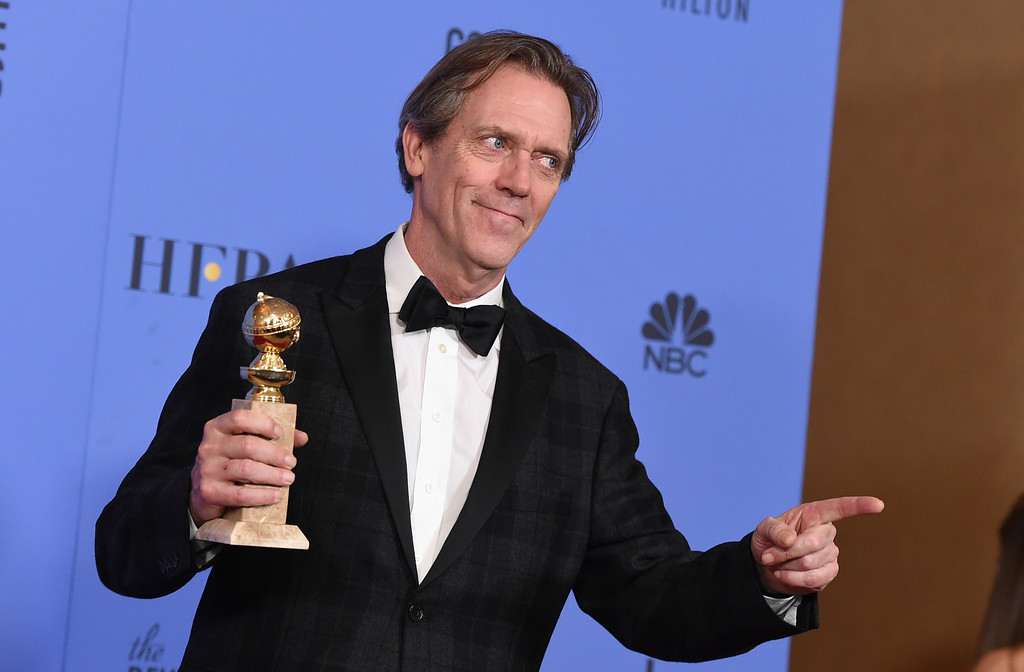 """. Hugh Laurie poses in the press room with the award for best performance by an actor in a supporting role in a series, limited series or motion picture made for television for \""""The Night Manager\"""" at the 74th annual Golden Globe Awards at the Beverly Hilton Hotel on Sunday, Jan. 8, 2017, in Beverly Hills, Calif. (Photo by Jordan Strauss/Invision/AP)"""