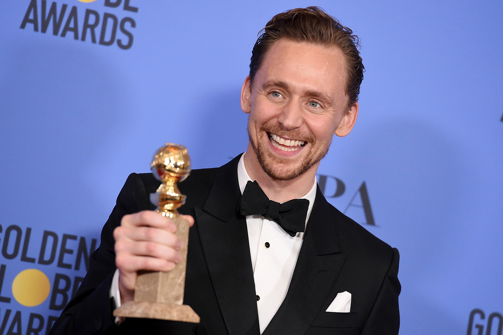 """. Tom Hiddleston poses in the press room with the award for best performance by an actor in a limited series or a motion picture made for television for \""""The Night Manager\"""" at the 74th annual Golden Globe Awards at the Beverly Hilton Hotel on Sunday, Jan. 8, 2017, in Beverly Hills, Calif. (Photo by Jordan Strauss/Invision/AP)"""
