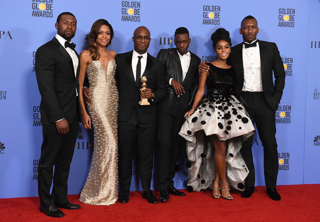""". The cast and crew of \""""Moonlight\"""" pose in press room with the award for best motion picture - drama at the 74th annual Golden Globe Awards at the Beverly Hilton Hotel on Sunday, Jan. 8, 2017, in Beverly Hills, Calif. From left are Trevante Rhodes, Naomie Harris, Barry Jenkins, Ashton Sanders, Janelle Monae, and Mahershala Ali. (Photo by Jordan Strauss/Invision/AP)"""