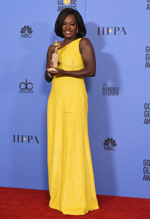 """. Viola Davis poses in the press room with the award for best performance by an actress in a supporting role in any motion picture for \""""Fences\"""" at the 74th annual Golden Globe Awards at the Beverly Hilton Hotel on Sunday, Jan. 8, 2017, in Beverly Hills, Calif. (Photo by Jordan Strauss/Invision/AP)"""