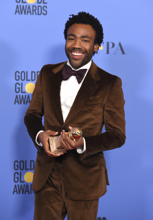 """. Donald Glover poses in the press room with the award for best performance by an actor in a television series - musical or comedy for \""""Atlanta\"""" at the 74th annual Golden Globe Awards at the Beverly Hilton Hotel on Sunday, Jan. 8, 2017, in Beverly Hills, Calif. (Photo by Jordan Strauss/Invision/AP)"""