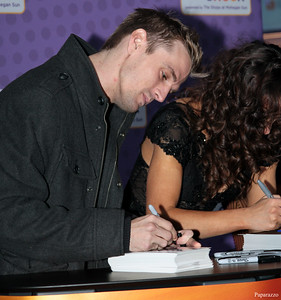 Aaron Carter and Karina Smirnoff sign autographs prior to the meet and greet at the Mohegan Sun Resort in Uncasville, Connecticut on January 3, 2016.
