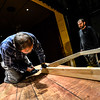 "KRISTOPHER RADDER - BRATTLEBORO REFORMER<br /> KRISTOPHER RADDER - BRATTLEBORO REFORMER<br /> Ed Dinning secures some of the floor beams on the two-level set on Jan. 10, 2017, for the Bellows Falls Opera House performance of ""Sweeney Todd: the Demon Barber of Fleet Street,"" that will open on Thursday, March 16 for a two-weekend run."