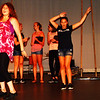 Debbie Blank | The Herald-Tribune<br /> Marisa Fullenkamp belts out a song about walking in the sand while her fellow stepsisters (behind her) and cat (far right) listen.