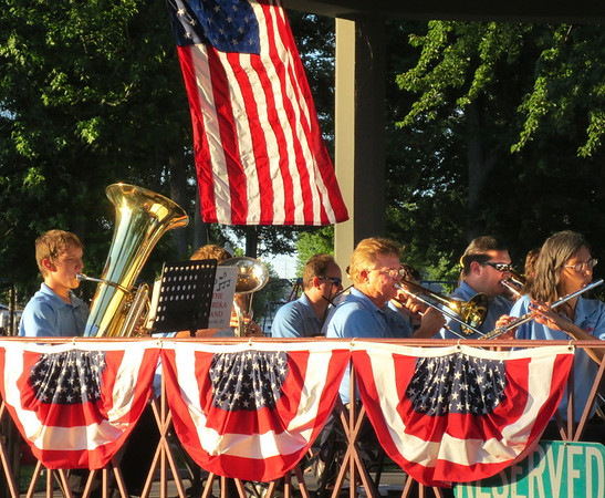 "Debbie Blank | The Herald-Tribune<br /> The community's volunteer Eureka Band under the direction of Mike Fritsch presented an all-American program at the Liberty Park bandstand just before the sun set July 4. About 100 listeners in lawn chairs applauded the patriotic series, which ranged from ""God Bless America"" and ""Americans We"" to ""The March of Freedom"" and ""Stars and Stripes Forever."""