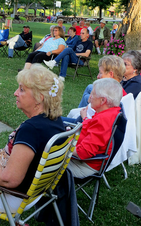 Debbie Blank | The Herald-Tribune<br /> As the attentive crowd listened to the July 4 performances, kids were swinging in the background and early fireworks were punctuating the rhythmic sounds as car horns tooted their approval<br /> after each piece, just as they have done for years.