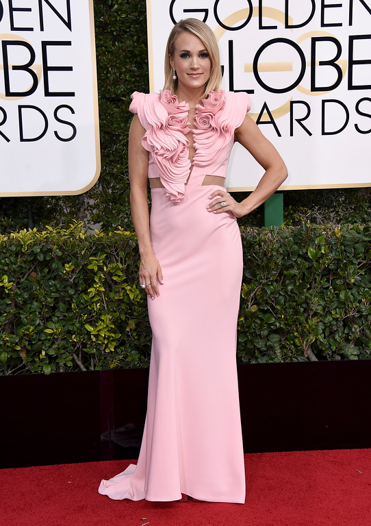 . Carrie Underwood arrives at the 74th annual Golden Globe Awards at the Beverly Hilton Hotel on Sunday, Jan. 8, 2017, in Beverly Hills, Calif. (Photo by Jordan Strauss/Invision/AP)