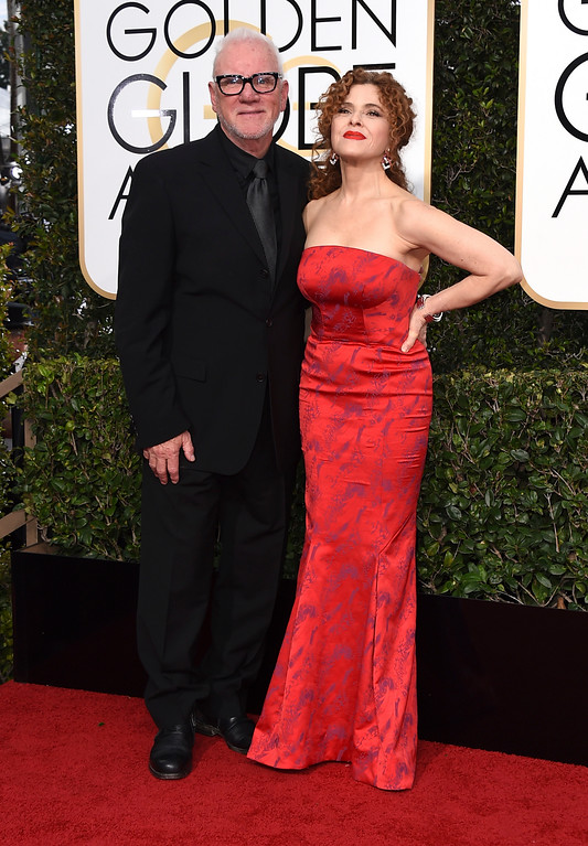 . Malcolm McDowell, left, and Bernadette Peters arrive at the 74th annual Golden Globe Awards at the Beverly Hilton Hotel on Sunday, Jan. 8, 2017, in Beverly Hills, Calif. (Photo by Jordan Strauss/Invision/AP)