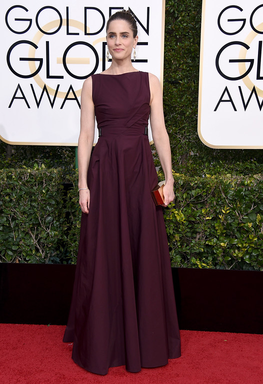 . Amanda Peet arrives at the 74th annual Golden Globe Awards at the Beverly Hilton Hotel on Sunday, Jan. 8, 2017, in Beverly Hills, Calif. (Photo by Jordan Strauss/Invision/AP)
